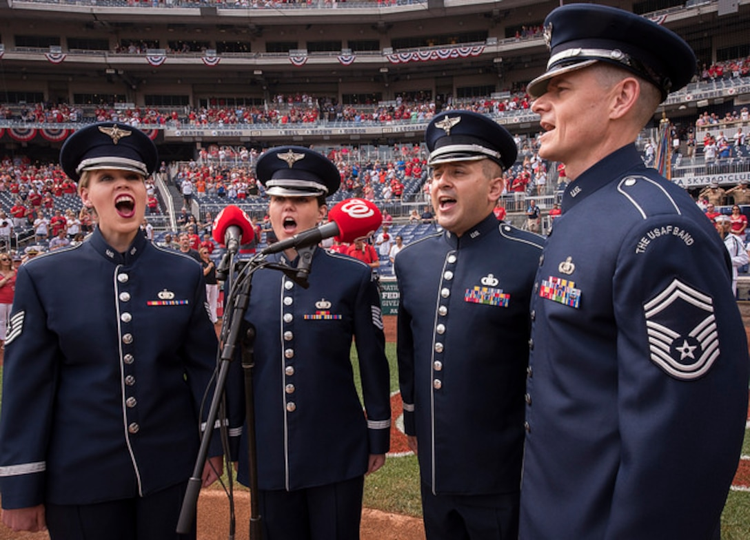 Members of the United States Air Force Band's Singing Sergeants perform the National Anthem before a home game at the Washington Nationals Park July 4, 2017, Washington, D.C.