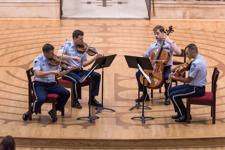 Image of a string quartet performing in uniform