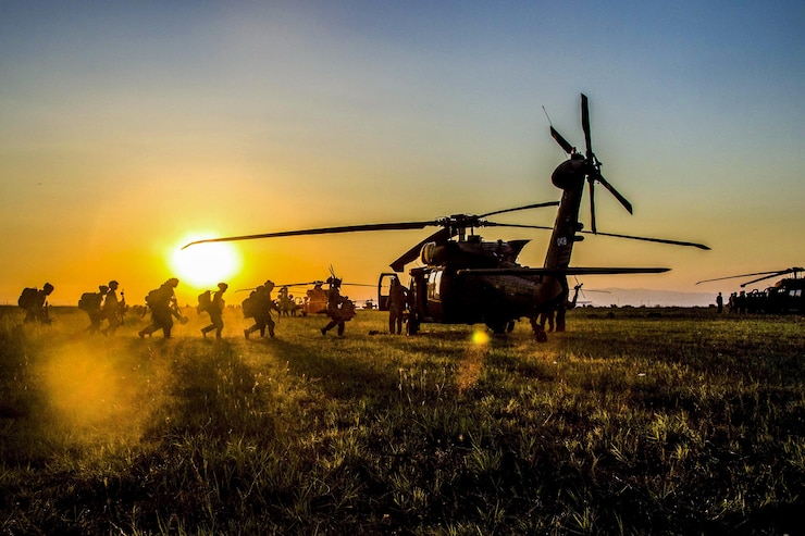 Soldiers practice loading into a UH-60 Black Hawk helicopter at Bezmer Air Base, Bulgaria, on July 21. The soldiers, assigned to the 173rd Airborne Brigade, prepped for Swift Response, an all-night air assault mission, during Saber Guardian 17 in the Black Sea region. Army photo by Spc. Thomas Scaggs