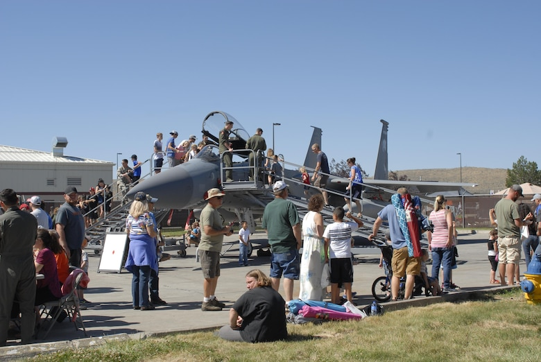 People crowd around a static display F-15 Eagle from the 173rd Fighter Wing during the Sentry Eagle Open House held July 22, 2017 at Kingsley Field in Klamath Falls, Oregon.  Sentry Eagle is a four day large force exercise that brings together different aircraft and units from around the country for dissimilar air combat training.  Additionally, the wing opens its gates to the public for a day during their biennial open house.  (U.S. Air National Guard photo by Master Sgt. Jennifer Shirar)