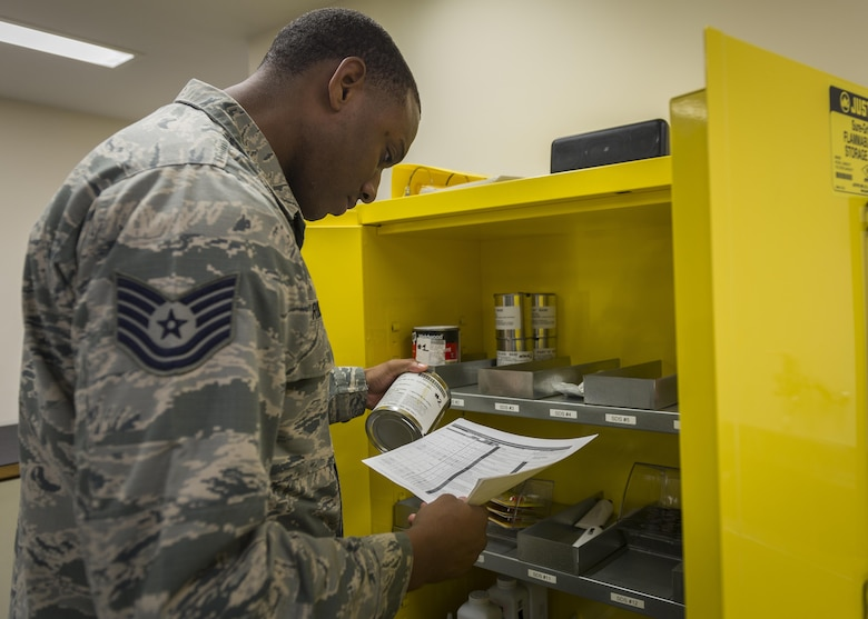 Tech. Sgt. Stephen Roberts, 339th Flight Test Squadron, Robins Air Force Base, Georgia, corrects write-ups for a Hazard communication program, July 18, 2017, at Yokota Air Base, Japan. The Hazcom program is intended to minimize the incidence of chemically induced occupational illnesses and injuries in the work area. (U.S. Air Force photo by Airman 1st Class Juan Torres)