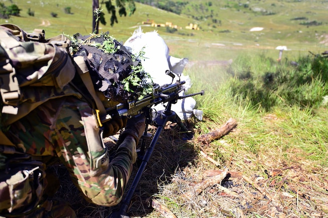 A paratrooper engages targets during a live-fire exercise as part of Exercise Rock Knight at Pocek Range in Postonja, Slovenia, July 25, 2017. Army photo by Davide Dalla Massara