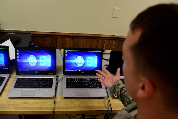 Airman 1st Class Joshua Burton, 4th Communications Squadron client services technician, discusses the process of migrating every computer on Seymour Johnson Air Force Base, North Carolina, to a new Windows 10 computer, July 12, 2017. According to Burton, every computer on base will be replaced with a new computer running Windows 10 by February 2018. (U.S. Air Force photo by Airman 1st Class Kenneth Boyton)