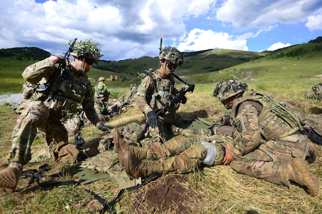 Paratroopers conduct tactical combat casualty care during a live-fire exercise as part of Exercise Rock Knight at Pocek Range in Postonja, Slovenia, July 25, 2017. Army photo by Davide Dalla Massara