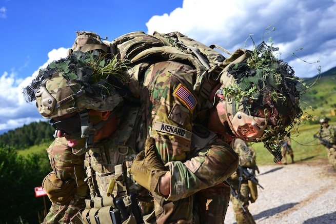 A paratrooper carries a mock casualty during a live-fire exercise as part of Exercise Rock Knight at Pocek Range in Postonja, Slovenia, July 25, 2017. Army photo by Davide Dalla Massara