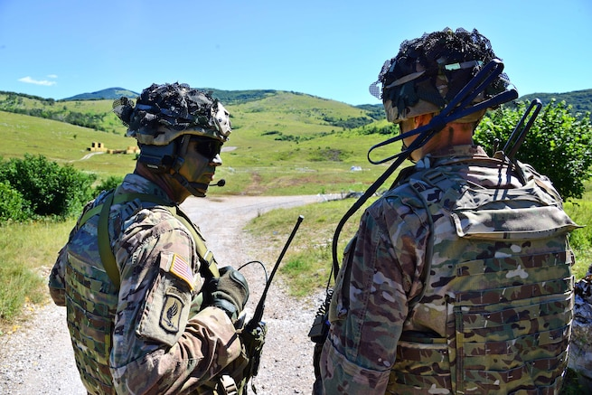 Army Lt. Col. Jim D. Keirsey, right, commander of 2nd Battalion, 503rd Infantry Regiment, 173rd Airborne Brigade, talks with Army Command Sgt. Maj. Wayne W. Wahlenmeier during a live-fire exercise as part of Exercise Rock Knight at Pocek Range in Postonja, Slovenia, July 25, 2017. Army photo by Paolo Bovo