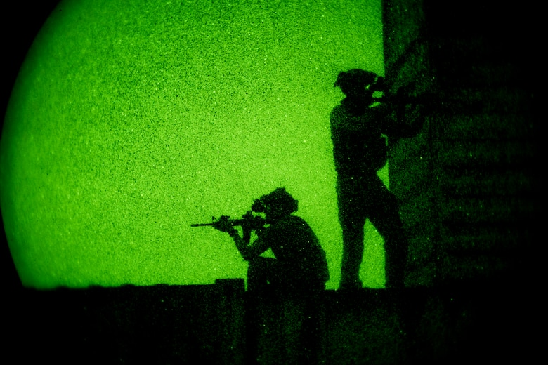 Pararescuemen from the 38th Rescue Squadron secure the perimeter under the cover of darkness during a rescue exercise, June 21, 2017, at Bemiss Field landing zone, Ga. The Air Force Research Laboratory from Wright-Patterson Air Force Base, Ohio and the Baltimore U.S. Air Force Center for Sustainment of Trauma and Readiness Skills, observed Moody's Combat Search and Rescue aeromedical patient processes and survival kit technology, in hopes of reducing risks to improve the overall Air Force mission. (U.S. Air Force photo by Airman 1st Class Daniel Snider)