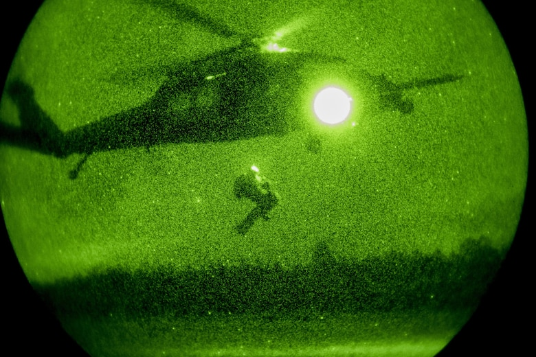 Pararescueman from the 38th Rescue Squadron extract a casualty into a hovering HH-60G Pave Hawk under the cover of darkness during a rescue exercise, June 21, 2017, at Bemiss Field landing zone, Ga. The Air Force Research Laboratory from Wright-Patterson Air Force Base, Ohio and the Baltimore U.S. Air Force Center for Sustainment of Trauma and Readiness Skills, observed Moody's Combat Search and Rescue aeromedical patient processes and survival kit technology, in hopes of reducing risks to improve the overall Air Force mission. (U.S. Air Force photo by Airman 1st Class Daniel Snider)
