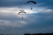 Pararescuemen from the 38th Rescue Squadron parachute towards the ground during a rescue exercise, June 21, 2017, at Bemiss Field landing zone, Ga. The Air Force Research Laboratory from Wright-Patterson Air Force Base, Ohio and the Baltimore U.S. Air Force Center for Sustainment of Trauma and Readiness Skills, observed Moody's Combat Search and Rescue aeromedical patient processes and survival kit technology, in hopes of reducing risks to improve the overall Air Force mission. (U.S. Air Force photo by Airman 1st Class Daniel Snider)