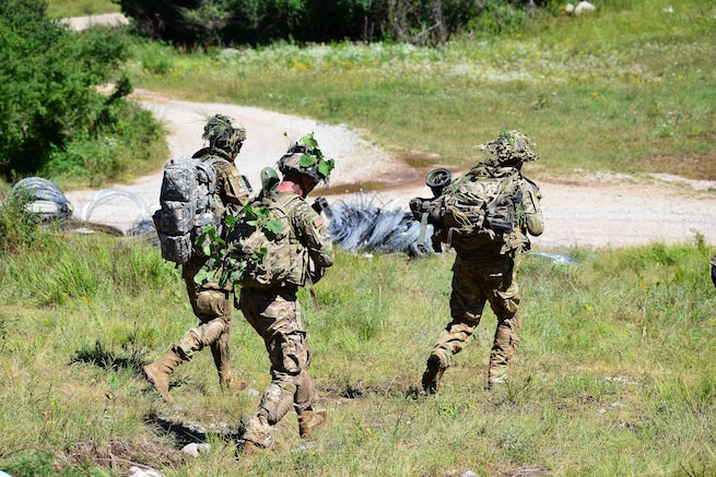 Paratroopers advance toward their follow-on objective during a live-fire exercise as part of Exercise Rock Knight at Pocek Range in Postonja, Slovenia, July 25, 2017. Army photo by Paolo Bovo