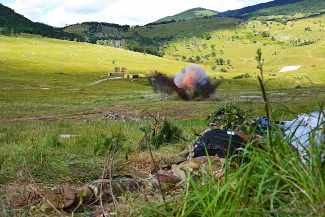 Paratroopers detonate an explosive charge to destroy a wire obstacle during a live-fire exercise as part of Exercise Rock Knight at Pocek Range in Postonja, Slovenia, July 25, 2017. Army photo by Paolo Bovo