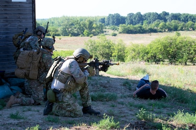 Hungarian special operations forces, and U.S. paratroopers assigned to the Army's 173rd Airborne Brigade engage an enemy quick reaction force during exercise Black Swan in Szolnik, Hungary, July 21, 2017. Army photo  by Staff Sgt. Aaron Duncan