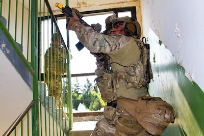 U.S. Special Forces soldiers clear a stairwell during an assault during exercise Black Swan in Szolnok, Hungary, July 21, 2017. Black Swan was a Hungarian-led special operations forces exercise held across locations in Bulgaria, Hungary and Romania from June 26-July 22, 2017. The exercise included participants from over eight countries. Paratroopers assigned to the U.S. Army's 173rd Airborne Brigade and 10th Combat Aviation Brigade also participated in the exercise alongside the 20th Special Forces Group to improve integration between special operations forces and conventional forces across NATO allies. Army photo by Staff Sgt. Aaron Duncan