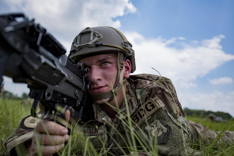 Airman 1st Class Sean Mullins, 823d Base Defense Squadron fire team member, secures a perimeter, July 21, 2017, at the Lee Fulp Drop Zone in Tifton, Ga. This training was in preparation for an upcoming mission readiness exercise where airmen serve as an airborne advanced team, with the mission to create an initial presence and clear a path for follow-on forces to arrive on scene. (U.S. Air Force photo by Airman 1st Class Daniel Snider)