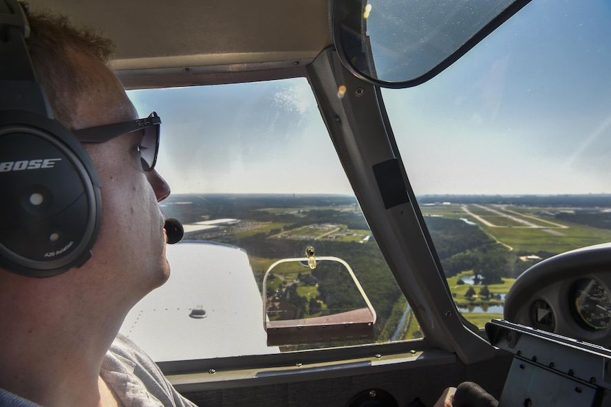 Maj. Ron Johnson, 437th Operations Support Squadron assistant director of operations, circles the airport before landing in Savannah, Ga., July 22, 2017. When Johnson's not flying for the 437th, he uses his personal plane and volunteer time to fly dogs from across the country to foster families and non-kill shelters for the Pilots N' Paws program.