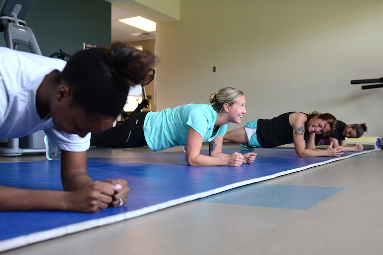 Second from left, Tech. Sgt. Kelsey Brunson, a fitness specialist from the 125th Force Support Squadron, leads the group in strength training during a fitness clinic July 20, 2017, at the 125th Fighter Wing in Jacksonville, Fla. Fitness comes easy for Brunson, who has a passion for working out. (U.S. Air National Guard photo by Staff Sgt. Carlynne DeVine)