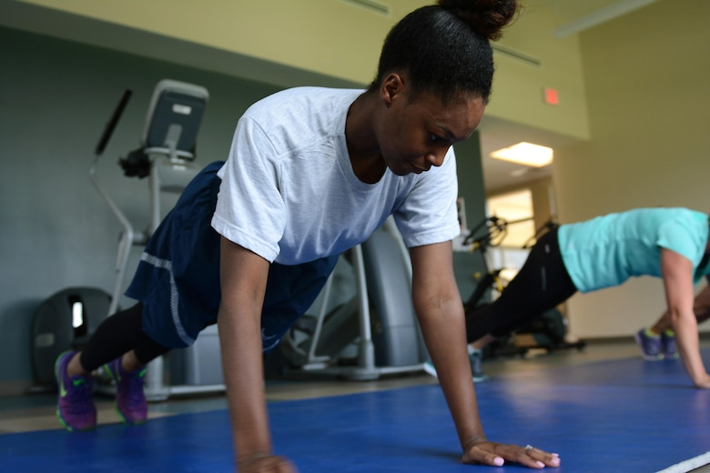Staff Sgt. Ivett Samuels, a base services assistant from the 125th Force Support Squadron, partakes in strength training during a fitness clinic July 20, 2017, at the 125th Fighter Wing in Jacksonville, Fla. The 125 FSS started offering fitness clinics as a way to encourage everyone on base to be active and stay fit. (U.S. Air National Guard photo by Staff Sgt. Carlynne DeVine)