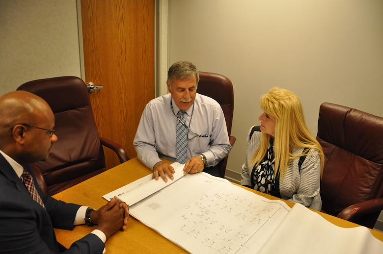 Dr. Mike Hassan (middle), chief of the Air Force Security Assistance and Cooperation Directorate's Construction Branch, confers with Dr. Carlos Braziel, section chief for Requirements and Small Programs and Diane DiTommaso, program manager,  on a construction project overseas. (U.S. Air Force photo/Brian Brackens)