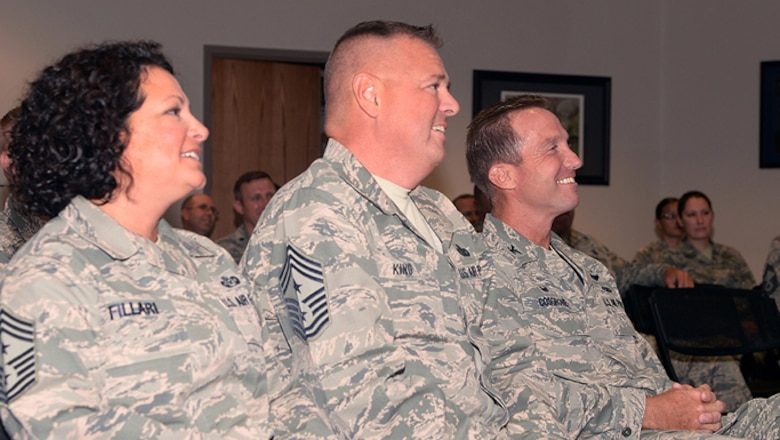 A picture of New Jersey Air National Guard Command Chief Master Sgt. Janeen Fillari, 1st Air Force Command Chief Master Sgt. Richard King and Col. John Cosgrove, maintenance group commander of the 177th Fighter Wing, attending an awards ceremony.