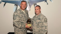 1st Air Force Command Chief Master Sgt. Richard King presents Master Sgt. Kevin Allman with the award for the Continental NORAD Region Aerospace Control Alert Security Forces Member of the Year on July 26, 2017, in Egg Harbor Township, N.J.  King presented Allman with this award for outstanding execution of the Aerospace Control Alert Mission. (U.S. Air National Guard photo by Airman 1st Class Cristina J. Allen/Released)