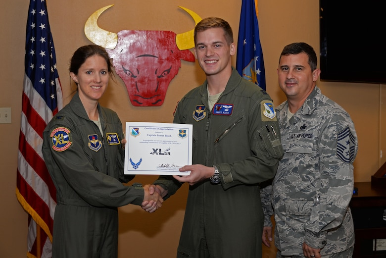 "Capt. James Bloch, 87th Flying Training Squadron instructor pilot, was chosen by wing leadership to be this week's ""XLer,"" July 12. The ""XLer"" award, presented by Col. Michelle Pryor, 47th Flying Training Wing vice commander, and Chief Master Sgt. George Richey, 47th FTW command chief, is given to those who consistently make outstanding contributions to their unit, and Laughlin's mission."