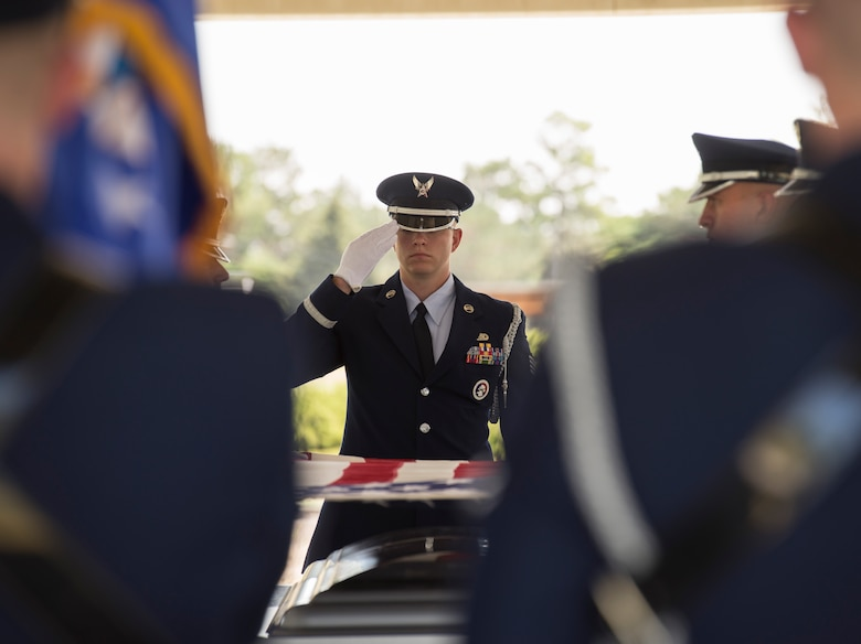 A Honor Guard airman salutes the flag during a flag folding ceremony July 19, 2017, at Mountain Home Air Force Base, Idaho. Members of the Air Force Mobile Training Team visited the base with the goal of standardizing sequences and standards throughout the Air Force. (U.S. Air Force photo by Senior Airman Jessica H. Smith/Released)