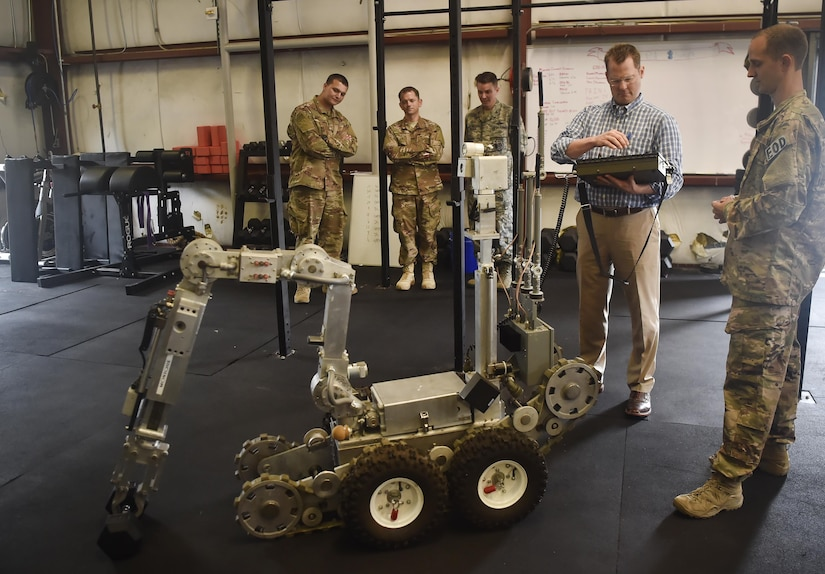 Lt. Gov. of South Carolina Kevin Bryant, right, operates a robot alongside 628th Civil Engineer Squadron explosive ordnance disposal team Airmen, during a visit here July 26. Bryant toured Joint Base Charleston to meet and thank military and civilian first responders for their service to the country and their efforts to support the local community. Bryant toured a C-17 Globemaster III, the installation fire department and received hands-on equipment familiarization from 628th CES EOD team Airmen. (U.S. Air Force photo by Staff Sgt. Christopher Hubenthal)