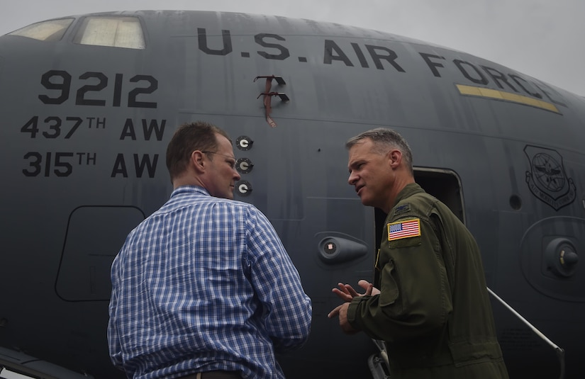 Lt. Gov. of South Carolina Kevin Bryant, left, talks to Col. Stephen Lanier, right, 315th Operations Group commander, during a tour of a C-17 Globemaster III as part of a visit here, July 26. Bryant toured Joint Base Charleston to meet and thank military and civilian first responders for their service to the country and their efforts to support the local community. Bryant toured a C-17 Globemaster III, the installation fire department and received hands-on equipment familiarization from 628th Civil Engineer Squadron explosive ordinance disposal team Airmen. (U.S. Air Force photo by Staff Sgt. Christopher Hubenthal)