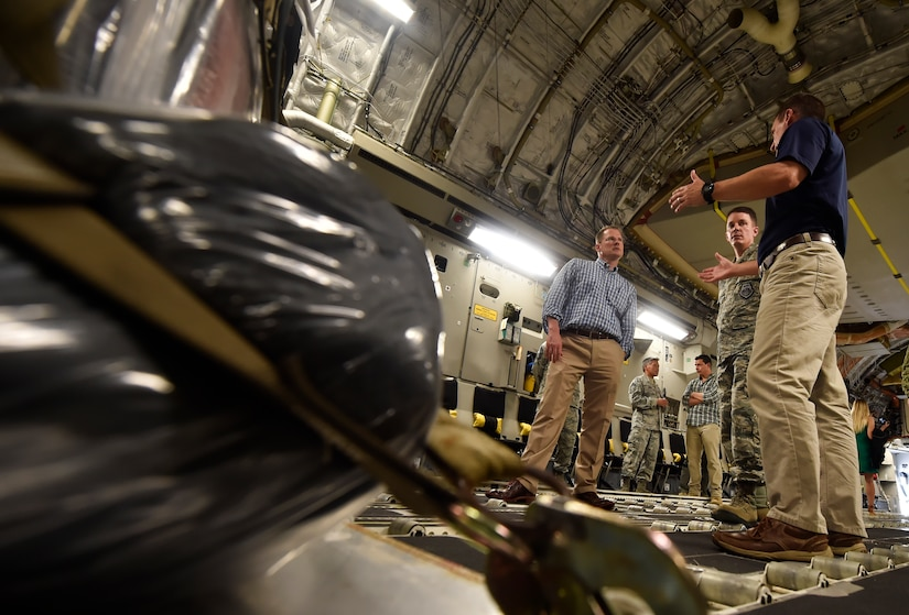 Kenneth Hundemer, right, 437th Aerial Port Squadron, briefs Lt. Gov. of South Carolina Kevin Bryant, left, and Col. Jeff Nelson, center, 628th Air Base Wing commander, during a tour of a C-17 Globemaster III as part of a visit here, July 26. Bryant toured Joint Base Charleston to meet and thank military and civilian first responders for their service to the country and their efforts to support the local community. Bryant toured a C-17 Globemaster III, the installation fire department and received hands-on equipment familiarization from 628th Civil Engineer Squadron explosive ordinance disposal team Airmen. (U.S. Air Force photo by Staff Sgt. Christopher Hubenthal)