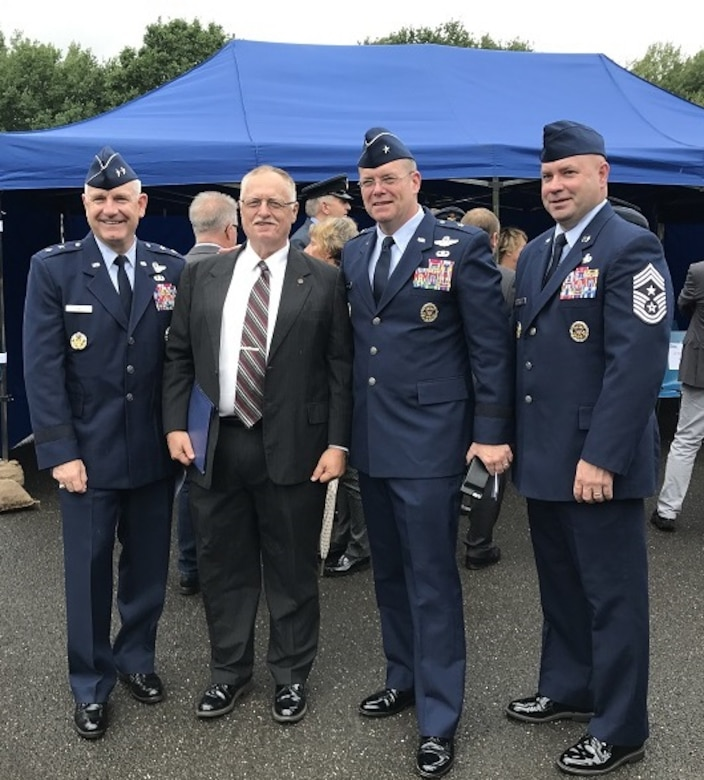 """Maj. Gen. Timothy Fay, vice commander U.S. Air Forces in Europe, Dr. Silvano Wueschner, Air University historian, Brig. Gen. Richard G. Moore, commander 86 Airlift Wing and Chief Master Sgt. Aaron D. Bennett, 86 Airlift Wing command, pose for a photo before the dedication of memorial for Royal Air Force Squadron leader Roger Bushell and French Air Force 2nd Lt. Bernad Scheidhauer, July 1, 2017, outside Ramstein, Germany.  Both men were part of the """"Great Escapees,"""" who were executed by the Gestapo on March 29, 1944 near present-day Ramstein Air Base. (U.S. Air Force photo by Staff Sgt. Timothy Moore)"""