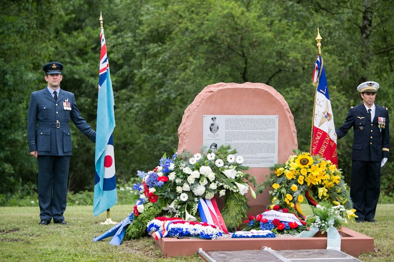 """Royal Air Force and French Air Force Honor Guards stand next to a monument dedicated to the memory of RAF Squadron leader Roger Bushell and FAF 2nd Lt. Bernad Scheidhauer, July 1, 2017.  Both men were part of the """"Great Escapees,"""" who were executed by the Gestapo on March 29, 1944 near present-day Ramstein Air Base. (U.S. Air Force photo by Staff Sgt. Timothy Moore)"""