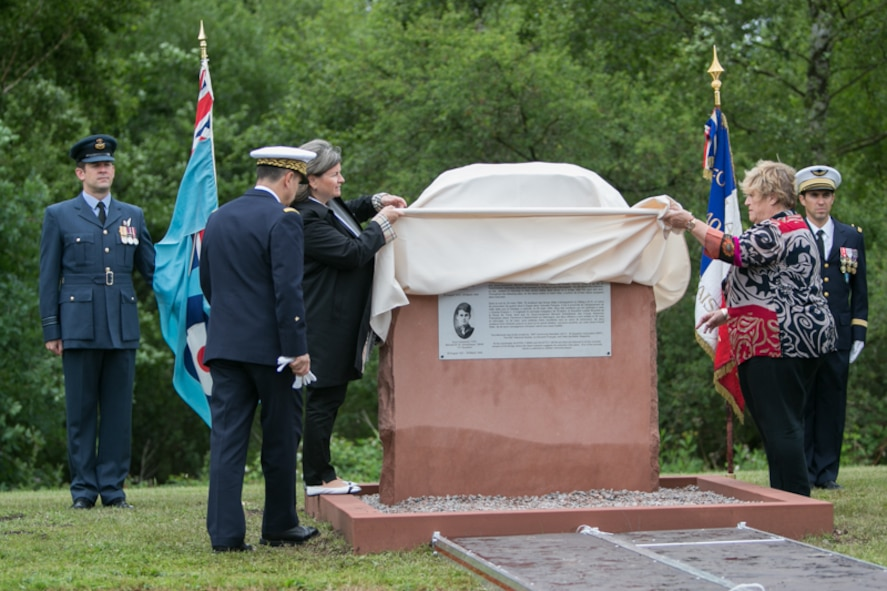 """Christelle Magnee, French Air Force 2nd Lt. Bernad Scheidhauer's great niece, and Caroline Kennard, Royal Air Force Squadron leader Roger Bushell's niece, unveil a memorial to their relatives on July 1, 2017 outside Ramstein, German. Bushell and Scheidhauer were among the 76 Allied prisoners of war who had escaped from Luft Stalag III at Sagan, Germany (now Poland) on March 24, 1944, in what became known as """"The Great Escape.""""  (U.S. Air Force photo by Staff Sgt. Timothy Moore)"""