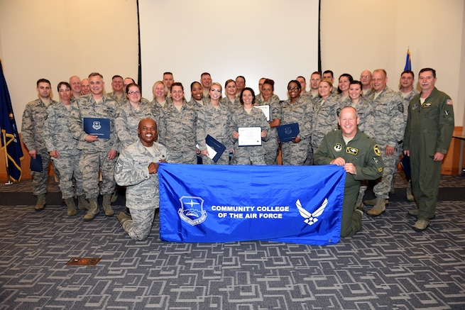 Standing behind Brig. Gen. John D. Slocum, commander of the 127th Wing and Chief Master Sgt. Tony Whitehead, 127th Command Chief, stand enlisted members of the 127th Wing after receiving their Community College of the Air Force diplomas during a ceremony at Selfridge Air National Guard Base at Selfridge Air National Guard Base, Mich., June.11, 2017.  The degrees earned ranged from Air & Space Operations Technology to Weather Technology and were awarded to Airmen from career fields around the Wing. (U.S. Air National Guard photo by MSgt. David Kujawa / Released)