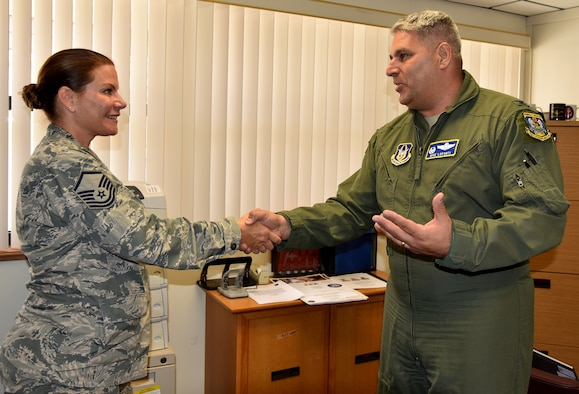 Col. Michael LoForti, 920th Operations Group commander, presents Master Sgt. Isabelle Klier-Graham, 920th Rescue Wing Equal Opportunity advisor, with his commander's coin July 9, 2017 to thank her for her assistance in the long-range rescue of two German citizens whose vessel caught fire approximately 500 nautical miles east of the Florida coastline in the Bermuda Triangle. Klier-Graham, a Bayreuth, Germany, native, worked as a German translator on the mission. (U.S. Air Force photo/Senior Airman Brandon Kalloo-Sanes)