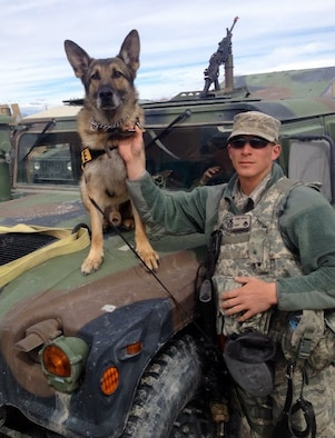 88 Security Forces Squadron Military Working Dog handler Staff Sgt. Seth Dale poses with MWD Blecki during a military exercise. Dale and Blecki traveled extensively during the 2016 election season in support of the United States Secret Service protective mission. (U.S. Air Force photo/Courtesy)