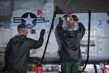 U.S. Air Force Airman 1st Class Jacob Mitchell and Senior Airman Caleb Mathre, 354th Aircraft Maintenance Unit airframe power plant general crew chiefs, clean an A-10C Thunderbolt II at Davis-Monthan Air Force Base, Ariz., July 25, 2017. The cleaning process can take crew chiefs three to four hours to complete. (U.S. Air Force photo by Airman 1st Class Michael X. Beyer)
