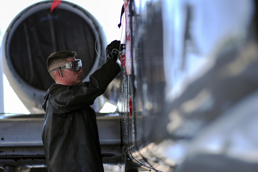 U.S. Air Force Airman 1st Class Jacob Mitchell, 354th Aircraft Maintenance Unit airframe power plant general crew chief, washes an A-10C Thunderbolt II at Davis-Monthan Air Force Base, Ariz., July 25, 2017. The A-10 is washed every six months to prevent buildup and corrosion. (U.S. Air Force photo by Airman 1st Class Michael X. Beyer)
