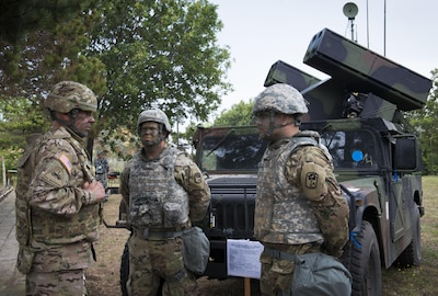 Col. David Shank, commander of the 10th Army Air and Missile Defense Command, speaks with Avenger team leader Army Sgt. Jesse Thomas and Avenger team member Army Spc. Dillion Whitlock with Charlie Battery, 2nd Battalion, 63rd Armored Regiment, South Carolina National Guard, during an air-defense live-fire exercise in Shabla, Bulgaria, July 18, 2017. The event comes as part of Tobruq Legacy 17, a multinational air defense exercise that demonstrates interoperability and communication between NATO allies and partners. DoD photo by Marine Corps Staff Sgt. Ben Flores