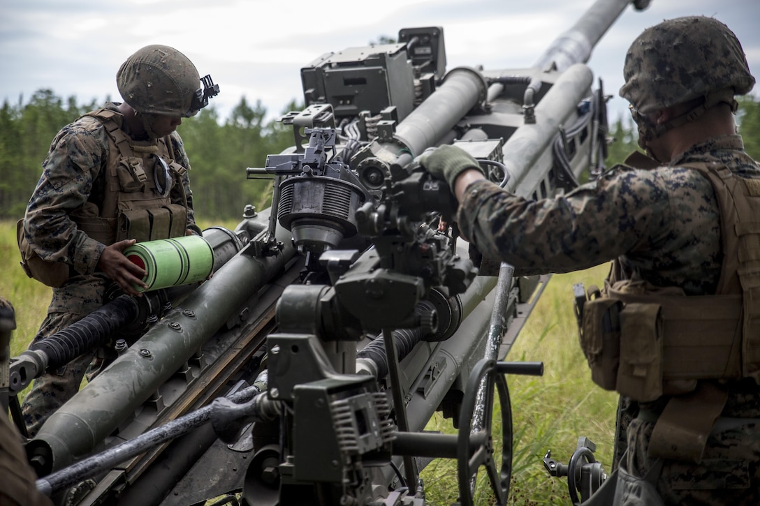 Marines load a charge into an M777A2 Howitzer during a live-fire range at Camp Lejeune, N.C., July 26, 2017. The purpose of this field operation is to test and improve the unit's capabilities by putting the Marines into a simulated combat environment. The Marines are with 1st Battalion, 10th Marine Regiment. (U.S. Marine Corps photo by Lance Cpl. Holly Pernell)
