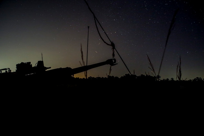 An M777A2 Howitzer stands ready to conduct night operations during a live-fire range at Camp Lejeune, N.C., July 26, 2017. The purpose of this field operation is to test and improve the unit's capabilities by putting the Marines into a simulated combat environment. The Exercise was conducted by 1st Battalion, 10th Marine Regiment. (U.S. Marine Corps photo by Lance Cpl. Holly Pernell)