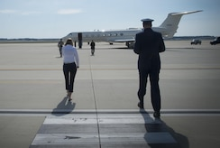 Katie Maynard, 89th Airlift Wing flight line protocol specialist (left), walks out to the flight line to greet an arriving distinguished visitor June 22, 2017, at Joint Base Andrews, Md. Airmen of the 89th AW flight line protocol office support more than 43,000 foreign and domestic dignitaries and staff. The Airmen also support approximately 3,500 distinguished visitor missions yearly.