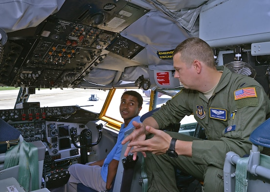 1st Lt. Kyle Swenson, 756th Air Refueling Squadron pilot, speaks to a career camp student about what it's like to be a pilot inside a KC-135 Stratotanker on the Joint Base Andrews, Maryland, flightline July 25, 2017. The high-school age students visited the 459th Air Refueling Wing to learn about careers available to them in the Air Force Reserve. (U.S. Air Force photo/Tech. Sgt. Erica Knight)