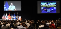 U.S. Air Force Gen. John. E. Hyten, commander of U.S. Strategic Command (USSTRATCOM), welcomes attendees to USSTRATCOM's annual Deterrence Symposium at the CenturyLink Center, Omaha, Neb., July 26, 2017. During the two-day symposium, industry, military, governmental, international and academic experts discussed and promoted increased collaboration to address 21st century strategic deterrence.