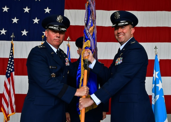 "U.S. Air Force Lt. Gen. Thomas Bergeson, 7th Air Force commander, passes the 51st Fighter Wing guidon to U.S. Air Force Col. William ""Wilbur"" Betts, 51st FW incoming commander, during the 51st FW Change of Command Ceremony on July 27, 2017, at Osan Air Base, Republic of Korea. The ceremony consisted of U.S. Air Force Col. Andrew ""Popeye"" Hansen relinquishing command of the 51st FW to U.S. Air Force Col. William ""Wilbur"" Betts. The 51st FW provides combat ready forces for close air support, air strike control, forward air control-airborne, combat search and rescue, counter air and fire, and interdiction in defense of the ROK. (U.S. Air Force photo by Senior Airman Franklin R. Ramos/Released)"