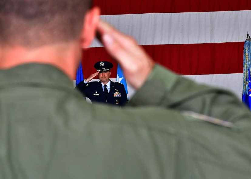 "U.S. Air Force Col. William ""Wilbur"" Betts, 51st Fighter Wing commander, returns a salute to members of the 51st FW during the wing's Change of Command Ceremony on July 27, 2017, at Osan Air Base, Republic of Korea. The ceremony consisted of U.S. Air Force Col. Andrew ""Popeye"" Hansen relinquishing command of the 51st FW to U.S. Air Force Col. William ""Wilbur"" Betts. The 51st FW provides combat ready forces for close air support, air strike control, forward air control-airborne, combat search and rescue, counter air and fire, and interdiction in defense of the ROK. (U.S. Air Force photo by Senior Airman Franklin R. Ramos/Released)"