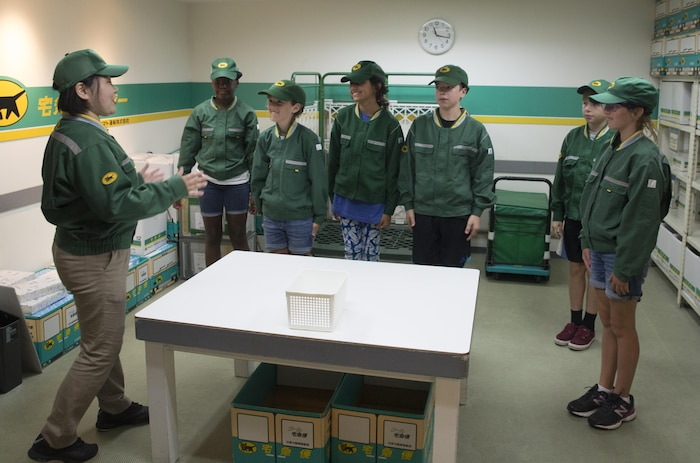 Children from Marine Corps Air Station Iwakuni role-play as couriers during a trip with the Youth and Teen Center to Kidzania in Kobe, Japan, July 26, 2017. Kidzania is an indoor education entertainment center that provides children the interactive experience of working adult jobs and earning currency. Children are able to dress up and role-play as adults in nearly 100 jobs and activities with each profession offering the chance to use life-like tools and equipment. (U.S. Marine Corps photo by Lance Cpl. Carlos Jimenez)