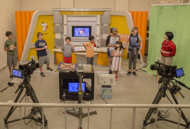 Youth and Teen Center members from Marine Corps Air Station Iwakuni role-play as news anchors and cameramen during a trip to Kidzania in Kobe, Japan, July 26, 2017. Kidzania is an indoor education entertainment center that provides children the interactive experience of working adult jobs and earning currency. A Youth and Teen Center staff member said the purpose of the trip was to give the children the opportunity to participate in Japanese culture and interact with Japanese children. (U.S. Marine Corps photo by Lance Cpl. Carlos Jimenez)