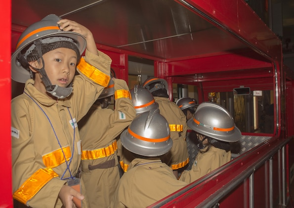 Japanese children role-play as firefighters during a trip to Kidzania in Kobe, Japan, July 26, 2017. Kidzania is themed as a child-sized replica of a real city including buildings, shops and theaters, as well as vehicles and pedestrians moving along its streets. Marine Corps Air Station Iwakuni residents visited the theme park as part of a Youth and Teen Center trip. (U.S. Marine Corps photo by Lance Cpl. Carlos Jimenez)