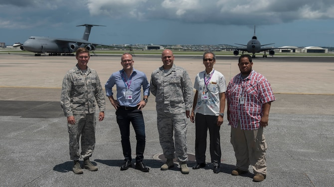 Peach Aviation Limited officials and U.S. Air Force 18th Operations Support Squadron airfield personnel stand for a group photo July 27, 2017, at Kadena Air Base. Peach Aviation executive vice president, José Oller, visited Kadena to personally thank flightline Airmen and contractors for their performance in handling a 12-aircraft diversion from Naha Airport.  Mr. Oller was a passenger aboard one of the flights that landed at Kadena. (U.S. Air Force photo by Staff Sgt. Peter Reft)