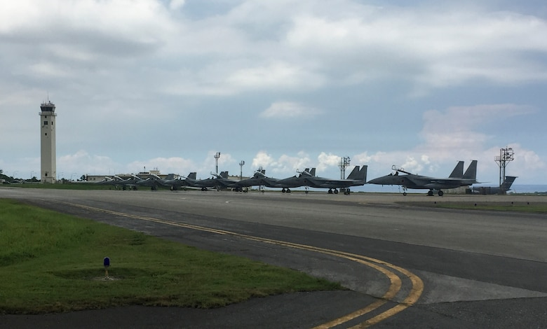 Japan Air Self-Defense Force F-15 Eagles standby for fuel July 26, 2017, at Kadena Air Base, Japan. The JASDF fighters diverted to Kadena for assistance when Naha Airport, their home station, closed its runway due to an aircraft malfunction incident. (U.S. Air Force photo by Master Sgt. Dustin Troyer)
